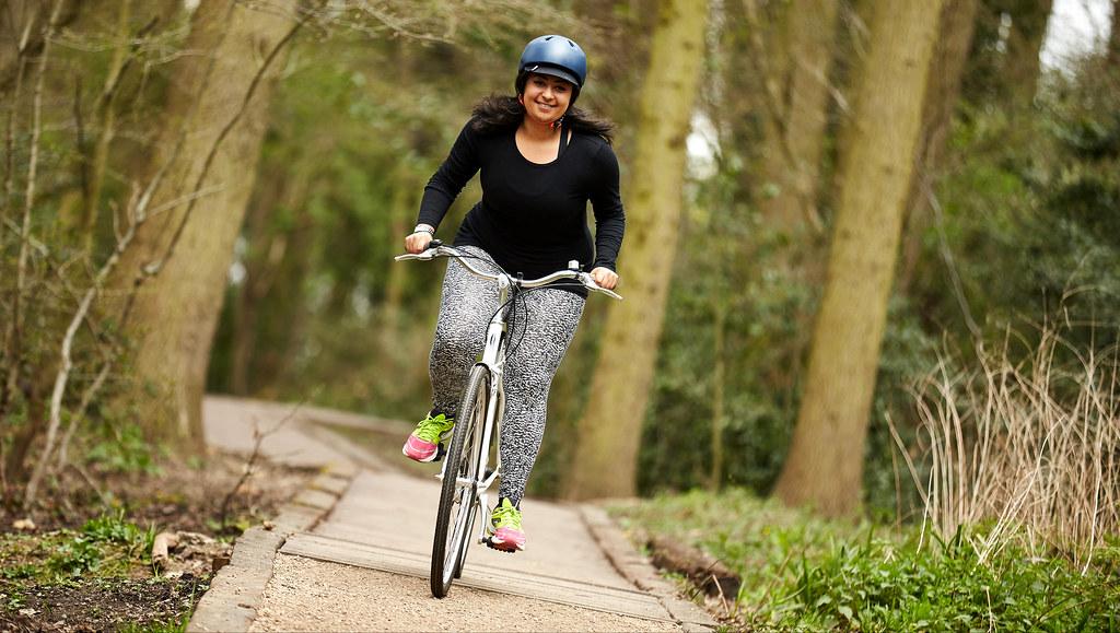 Woman cycling a bike