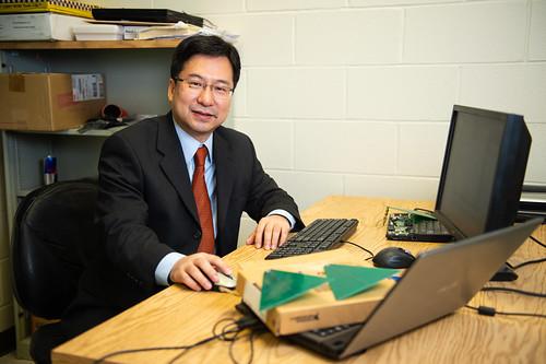 Shiwen Mao sits at a desk.