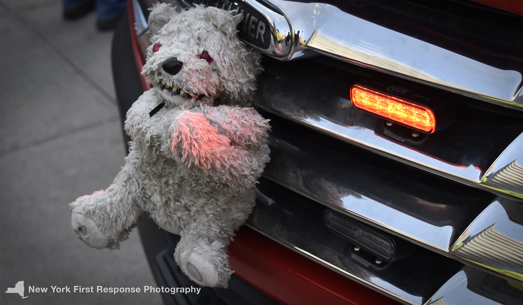 cca93a97ce4 ... Stuffed Animal on the grille of an FDNY vehicle