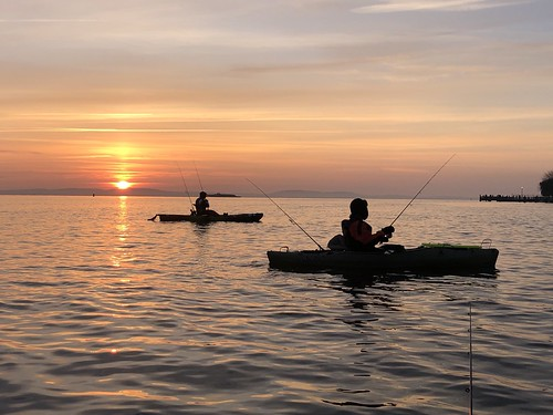 Photo of Kayak fishing at sunset