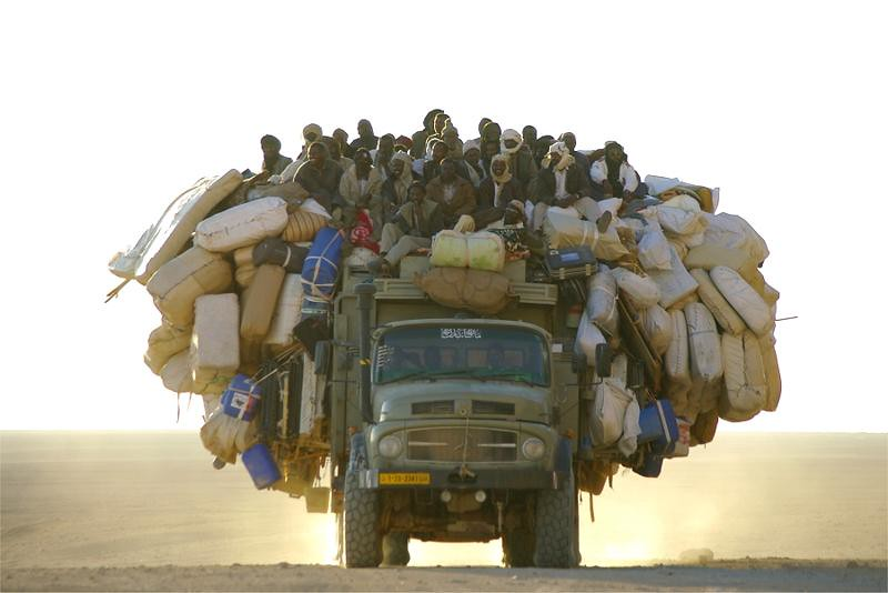 African truck loaded with people