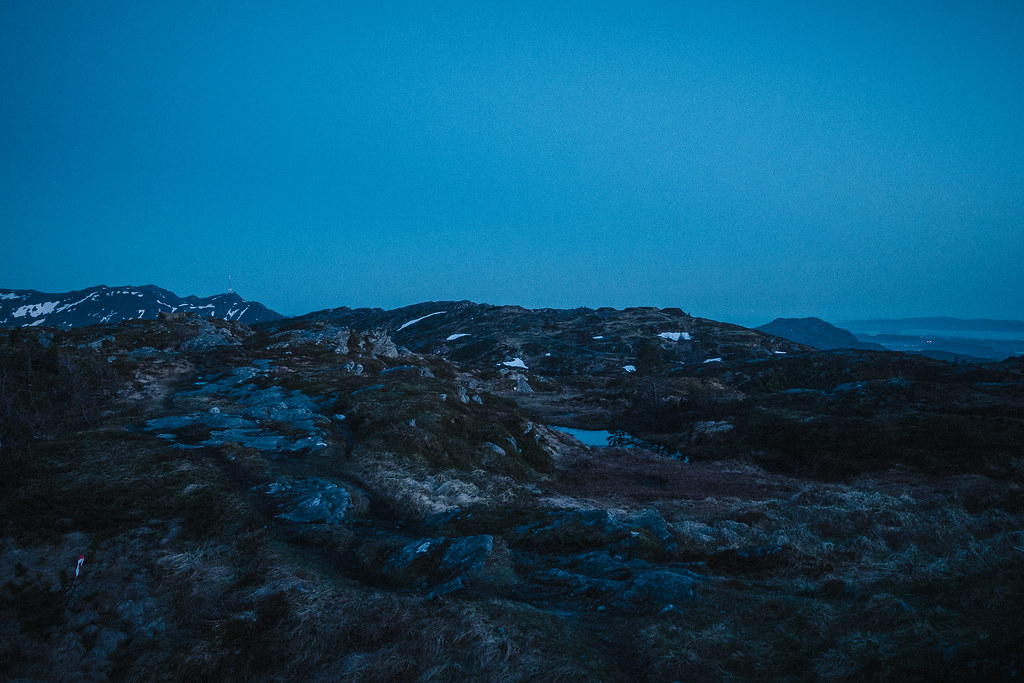 Mountain landscape at dusk just before it turns to night. Trails barely visible.