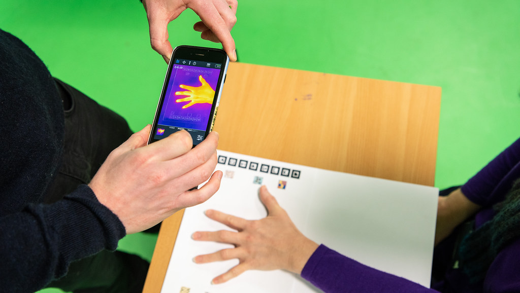 Taking a thermal image of patient's hand using a smartphone