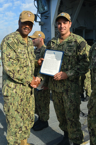 SAN DIEGO – The commander of Carrier Strike Group 1 visited guided-missile cruiser USS Lake Champlain (CG 57) while the ship was moored at Naval Base San Diego, Dec. 11.
