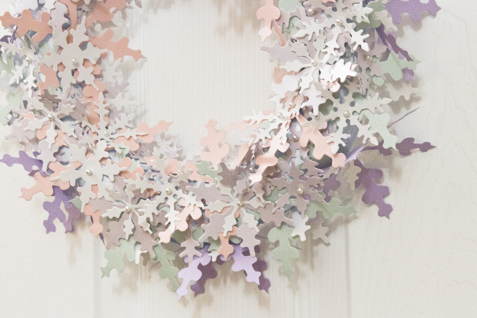 Snowflake wreath made from pastel coloured paper