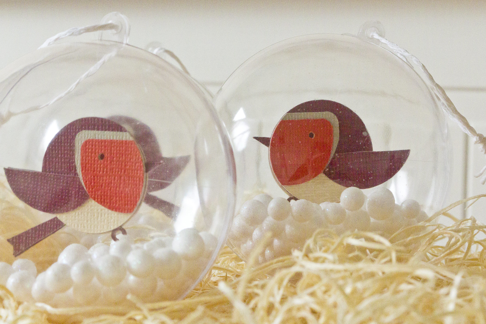 clear plastic baubles with robins. Fill your own baubles from poundland