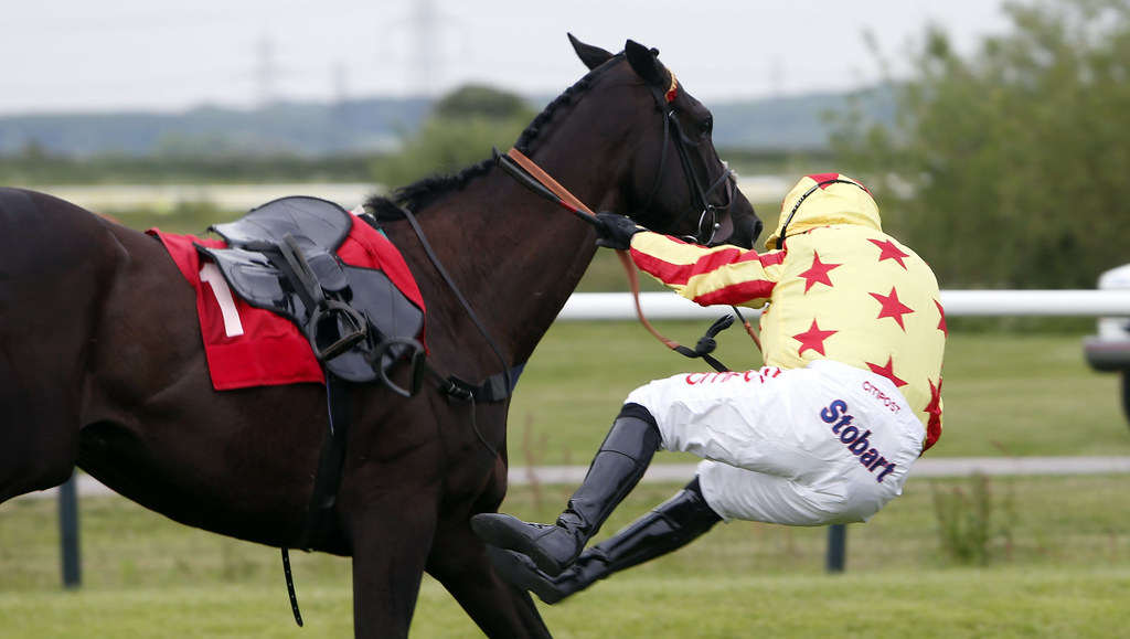 Rider falling off horse.