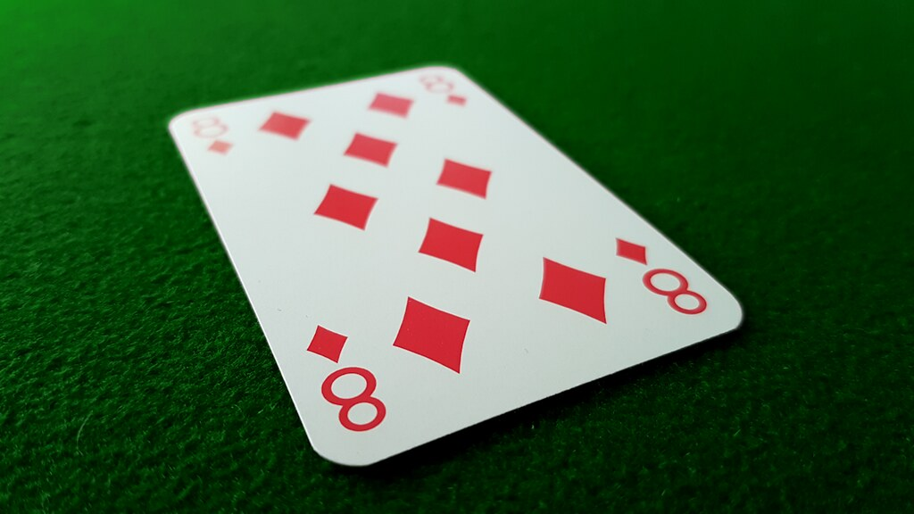 An eight card on a poker table.