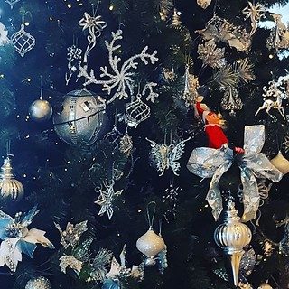 #elfantics #hideandseek #elfbehavingbadly Image description: Christmas tree covered in silver baubles and stars but look closely and find elf hiding | by easegill