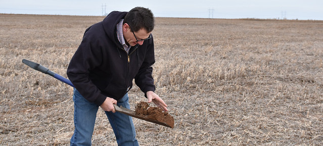 Gary Hula working with soil