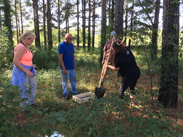 Recent trainees dig a survey plot