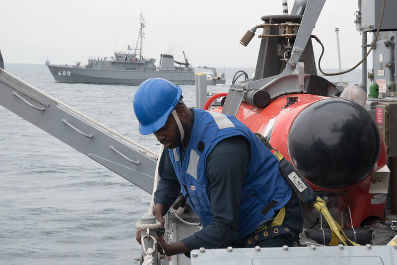Mineman 3rd Class Latron Jolly, from Hayward, California, removes safety lines in preparation to launch a mine neutralization vehicle aboard the Avenger-class mine countermeasures ship USS Chief (MCM 14) during Mine Warfare Exercise 3JA. The U.S. Navy, Japan Maritime Self-Defense Force and Royal Australian Navy are participating in the exercise to increase proficiency in mine countermeasure operations.