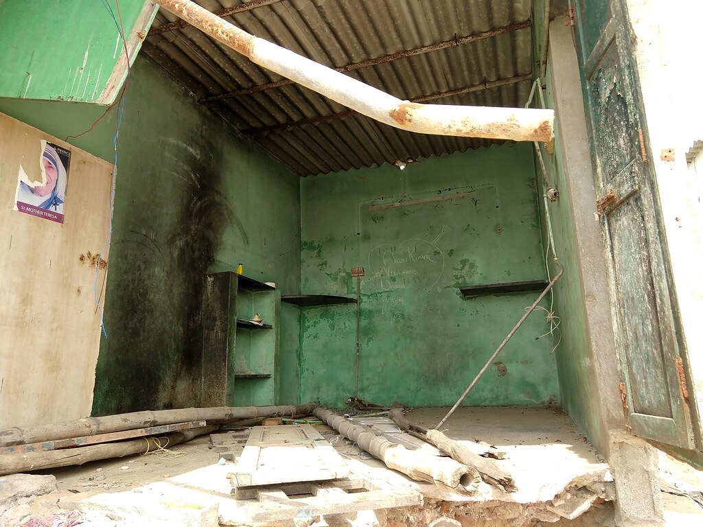 Love graffiti on wall of a house that fell down during last year's storm in Sreenivaspuram slum in Chennai