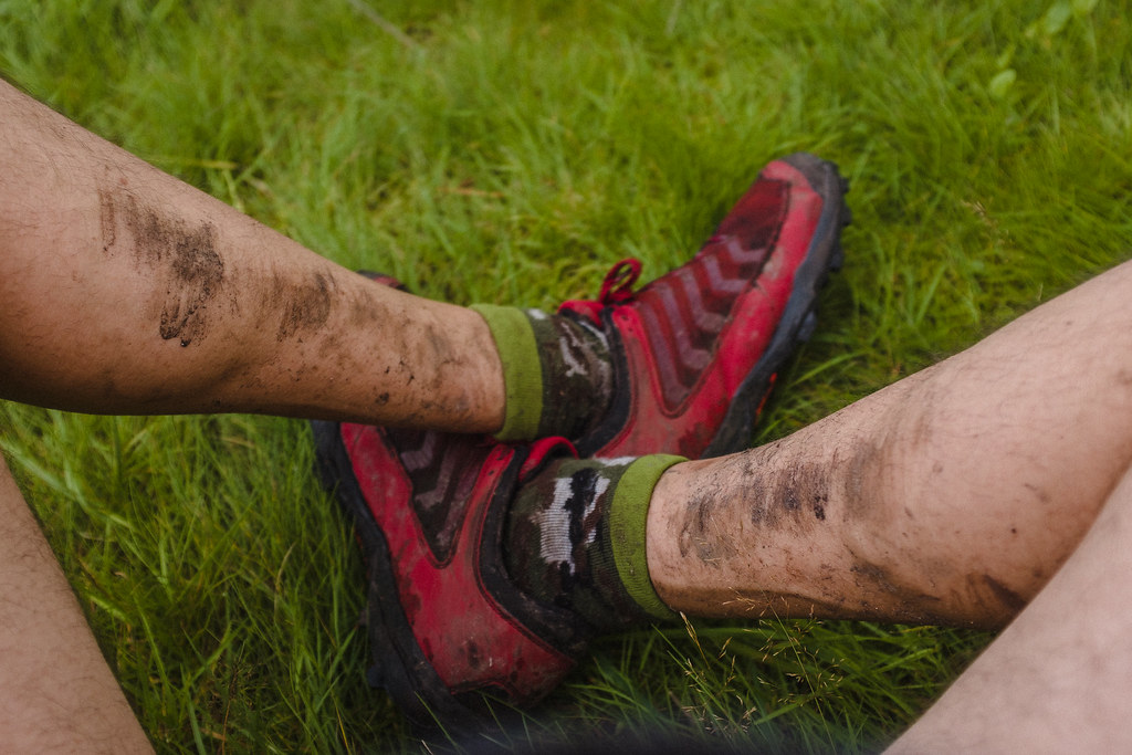 Inov-8 X-Claw 275 trail running shoes, dirty legs.