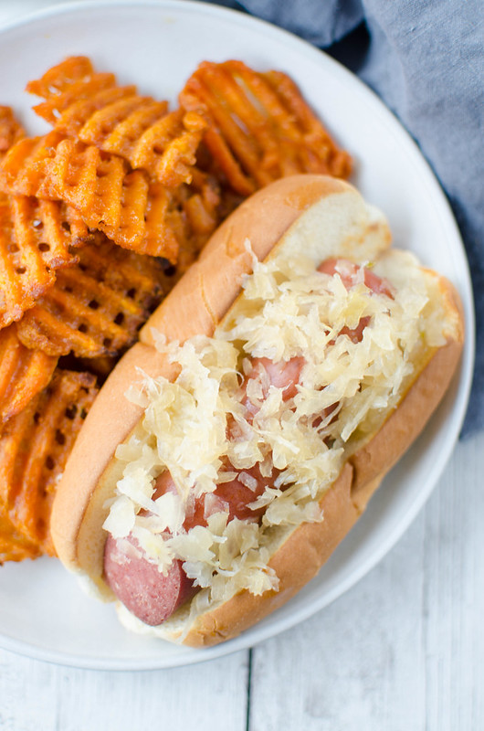 Crockpot Beer and Brown Sugar Kielbasa - kielbasa and sauerkraut cooked all day in the slow cooker in beer and brown sugar! It's sweet and sour and delicious! Perfect for Superbowl parties!