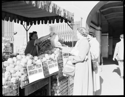 Oranges Central Station R.R.R [Railway Refreshment Room] girl serving two women. | by NSW State Archives and Records