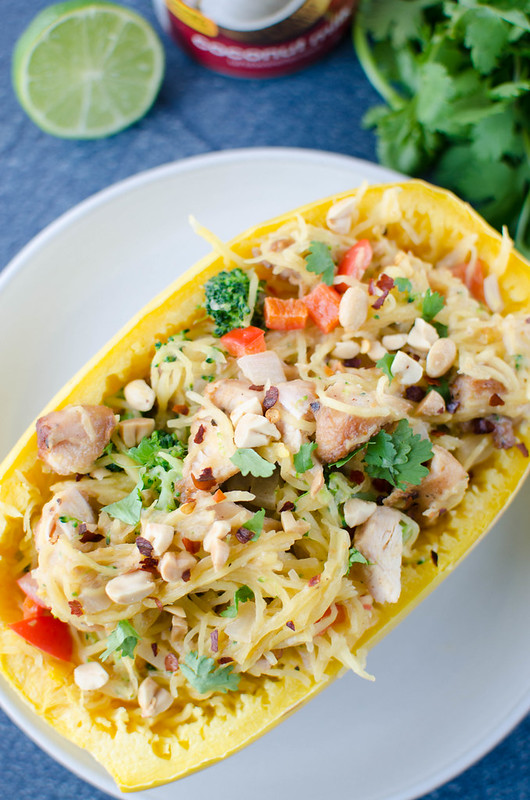 Thai Peanut Spaghetti Squash - chicken, broccoli, and bell peppers stuffed in a spaghetti squash and coated in a sweet and spicy, creamy peanut sauce. Low carb and dairy free!