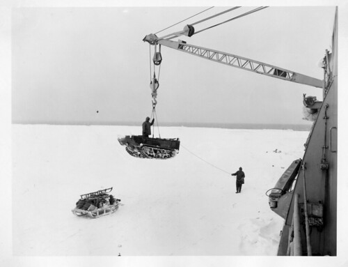 Operation Windmill Expedition Members Unloading Equipment | by Smithsonian Institution
