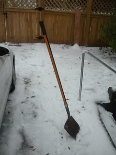 There's enough ice to hold a shovel upright. | by Jason Riedy