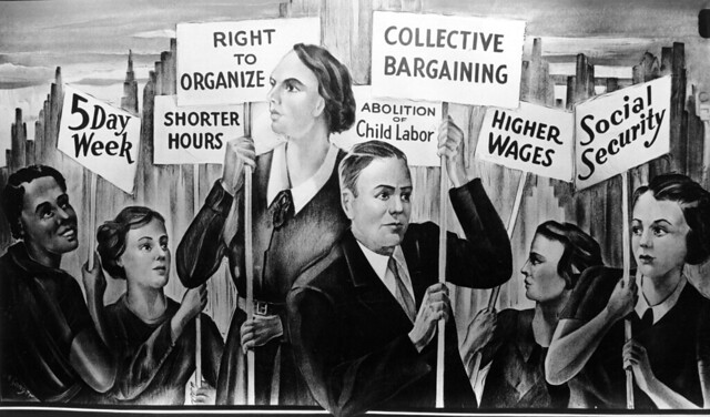 Mural of workers holding placards