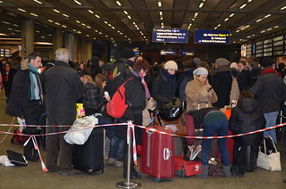Passangers in front of the departure boards in the queue at St Pancras International | by Ben Sutherland