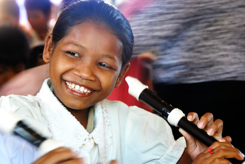 School girl playing recorder for the first time | by Chea Phal