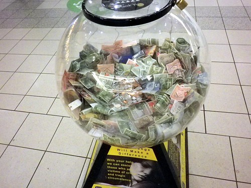 Foreign currency donation bucket filled with Canadian Tire money, security queue, Pearson Terminal 3, Toronto, ON, Canada | by gruntzooki