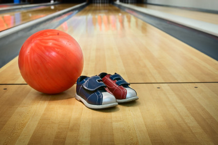 Bowling ball and bowling shoes at foul line in a bowlingla… | Flickr