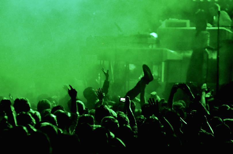Actor, Aziz Ansari, crowd surfing at LCD Soundsystem\'s fin… | Flickr