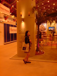 chinese lady in front of Arab Publisher stand | by Belinda Otas