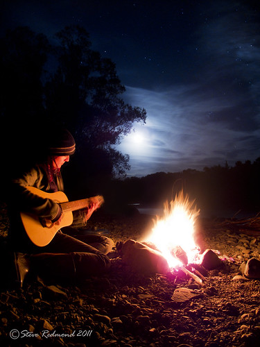 Campfire Song A Musician Playing By The Campfire Next To
