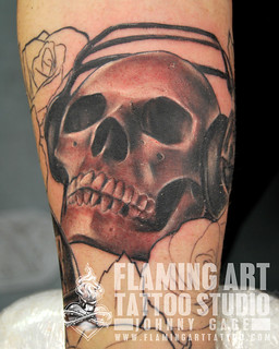 Ear phone skull tattoo | by johnny gage