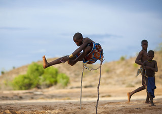 Mucubal kid jumping - Angola | by Eric Lafforgue