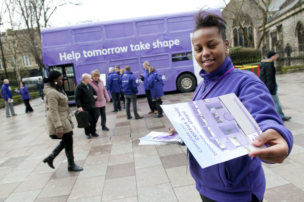 handing out leaflets at the 2011 census purple bus cardif flickr