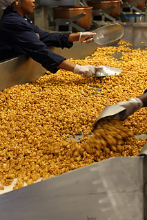 mixing caramel corn | by David Lebovitz