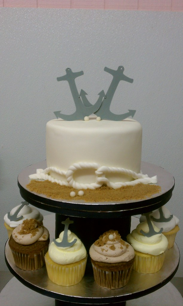 Nautical themed wedding cake and coordinating cupcakes Flickr