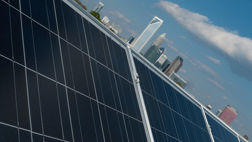 Charlotte skyline from Optima Engineering array | by North Carolina Solar Center