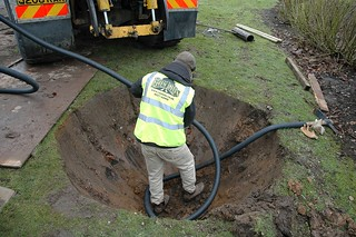 Stocker 2.16m Tree Spade installing aeration irrigation tube into planting pit | by Ruskins Trees