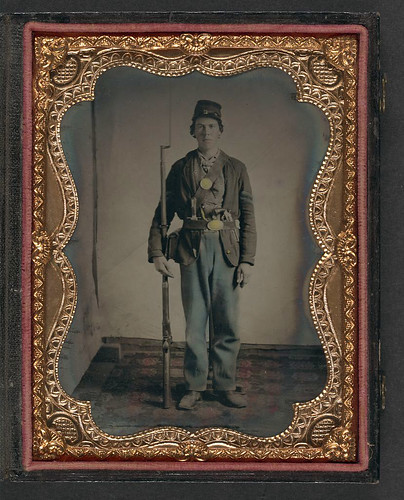 [Unidentified Young Soldier In Union Uniform On Rug With B