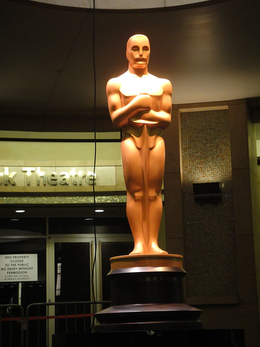 Preparing for the 83rd Annual Academy Awards - the giant Oscar statue at the Kodak Theater entrance | by Doug Kline