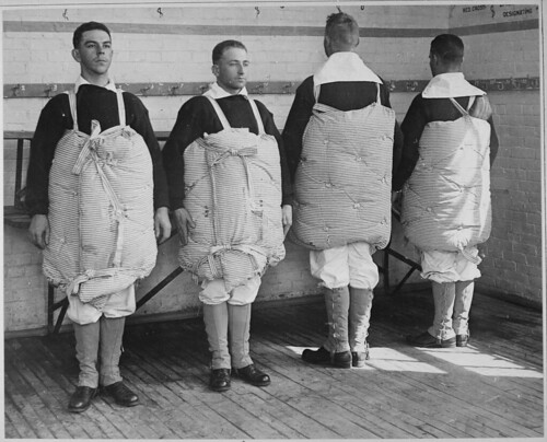 Recruits with their mattresses tied to them to serve as life preservers. | by The U.S. National Archives