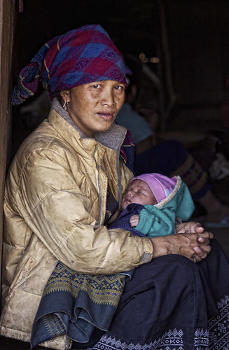 A Hmong Lady Cradles Her Baby | by El-Branden Brazil