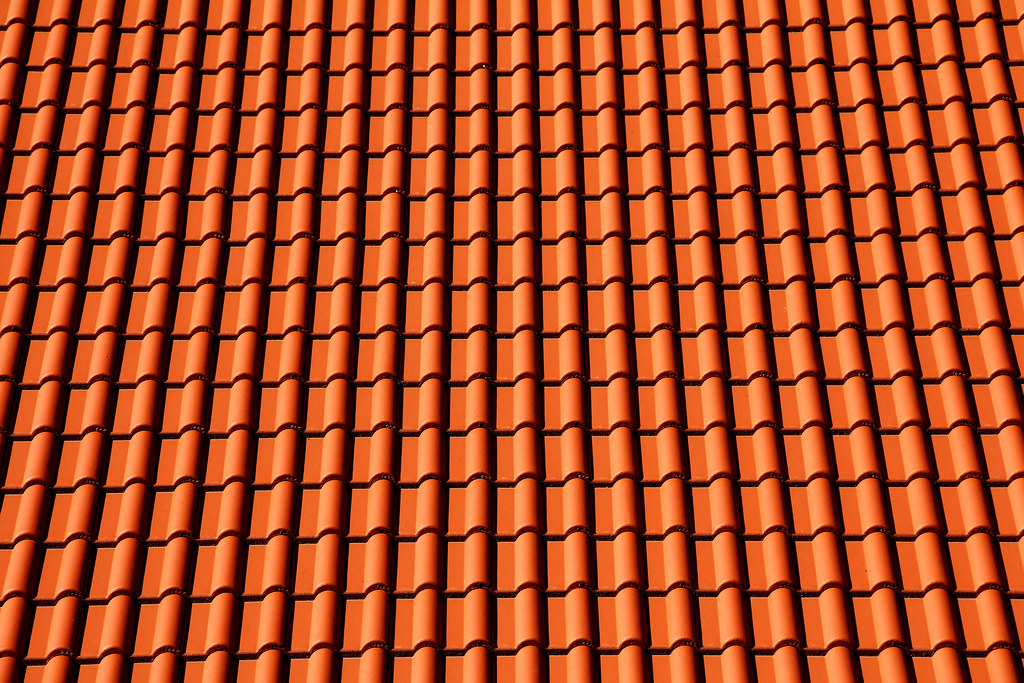 Roof pattern pattern of orange terracotta roof tiles sc for Roof tile patterns