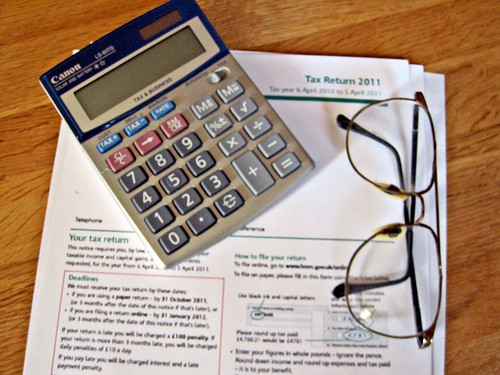How Much Is Tax >> Tax Return and Calculator | A tax return, a calculator and a… | Flickr
