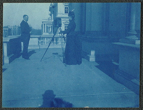 [Frances Benjamin Johnston on a balcony of the State, War and Navy Building with a tripod-mounted camera, photographing an unidentified man] (LOC) | by The Library of Congress