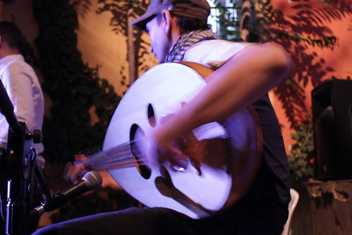 This musician strummed his guitar during one of the song performances. | by NU Journalism in Amman
