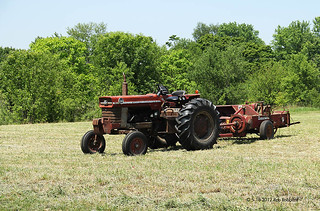An old Massey Ferguson tractor and an International Harvester hay bailer.. | by Rob Robbins
