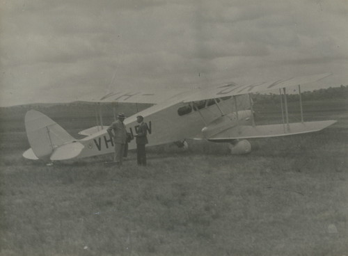 De Havilland DH.84 Dragon aeroplane VH-URV in field | by Powerhouse Museum Collection