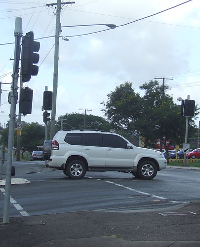 Dead traffic lights as car turns into Ipswich Road from Lucy St, Yeerongpilly - Flooding in Brisbane, Queensland, Australia 110112 | by David Jackmanson