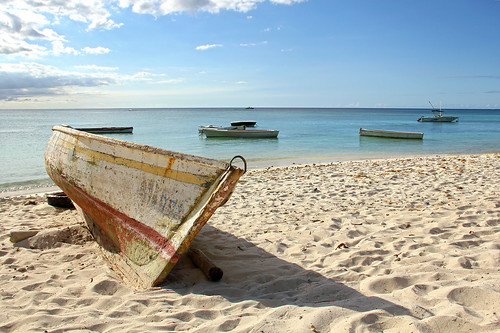 Mauritius - old battered boat on the beach 2 | by Romeodesign